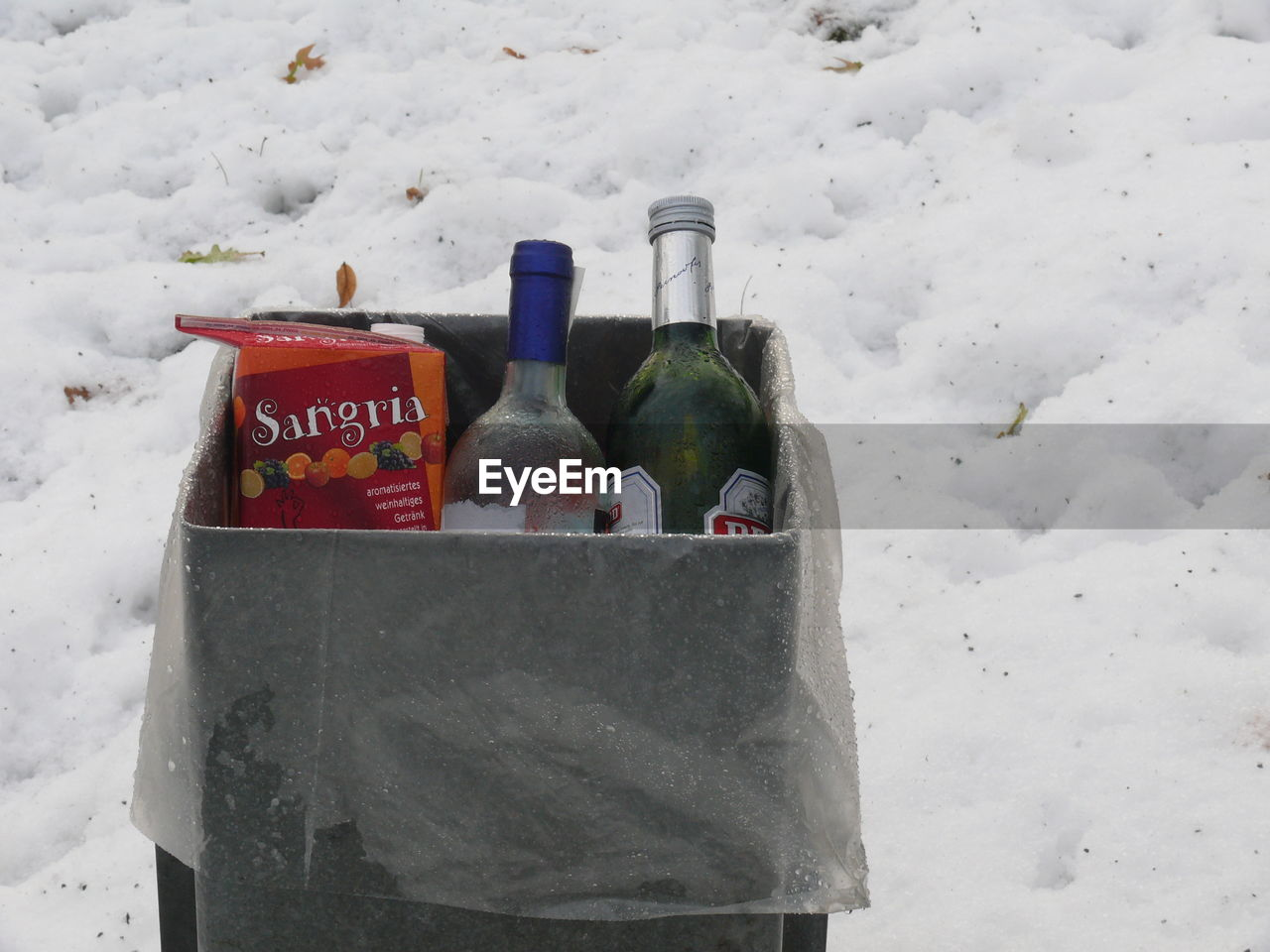 bottle, drink, cold temperature, snow, text, day, alcohol, no people, winter, outdoors, variation, close-up, nature