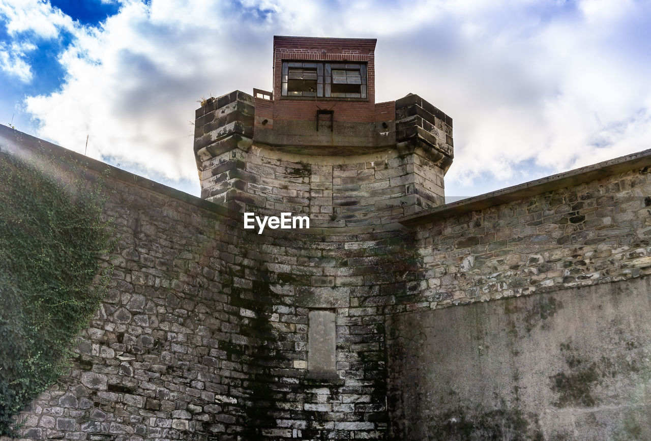 built structure, architecture, sky, building exterior, cloud - sky, low angle view, history, the past, wall, building, nature, day, no people, old, wall - building feature, stone wall, outdoors, tower, fort, castle, concrete