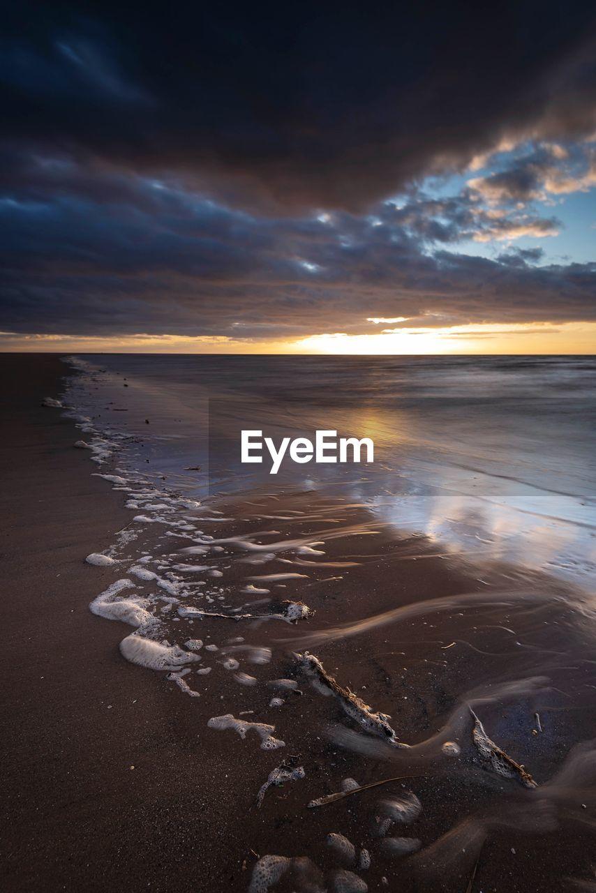 water, sky, beach, sea, cloud - sky, beauty in nature, land, scenics - nature, tranquility, sunset, tranquil scene, nature, sand, no people, reflection, idyllic, horizon over water, horizon, non-urban scene