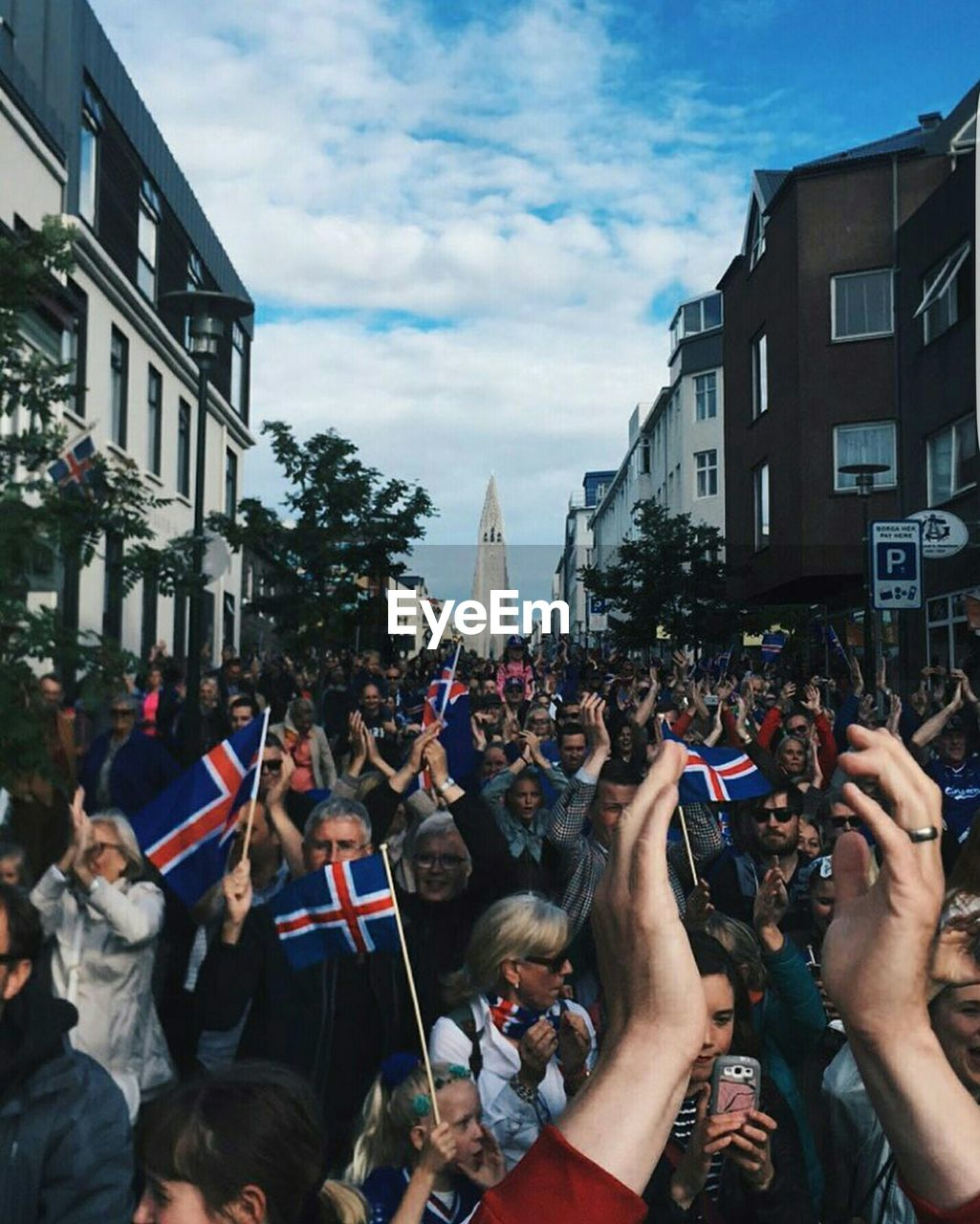 Soccer Fans Celebrating With Icelandic Flags On Street In City