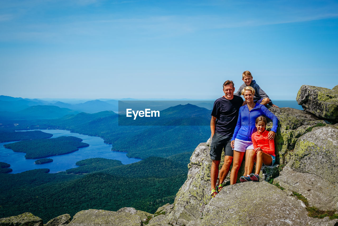 Portrait of smiling family on whiteface moutain against sky