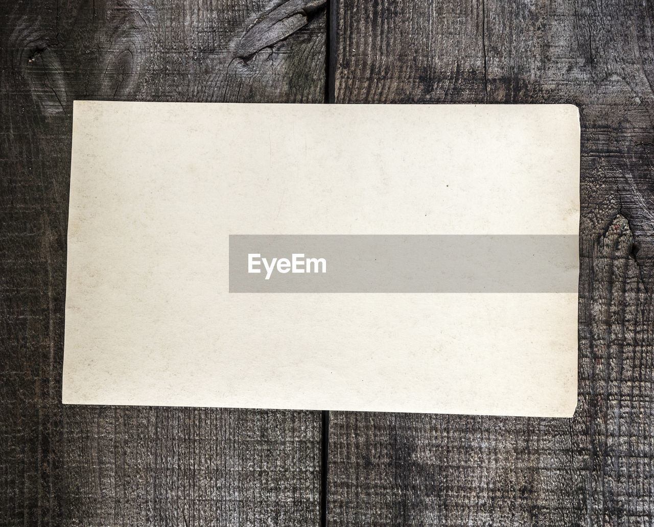 Directly Above Shot Of Grunge Blank Paper On Wooden Table