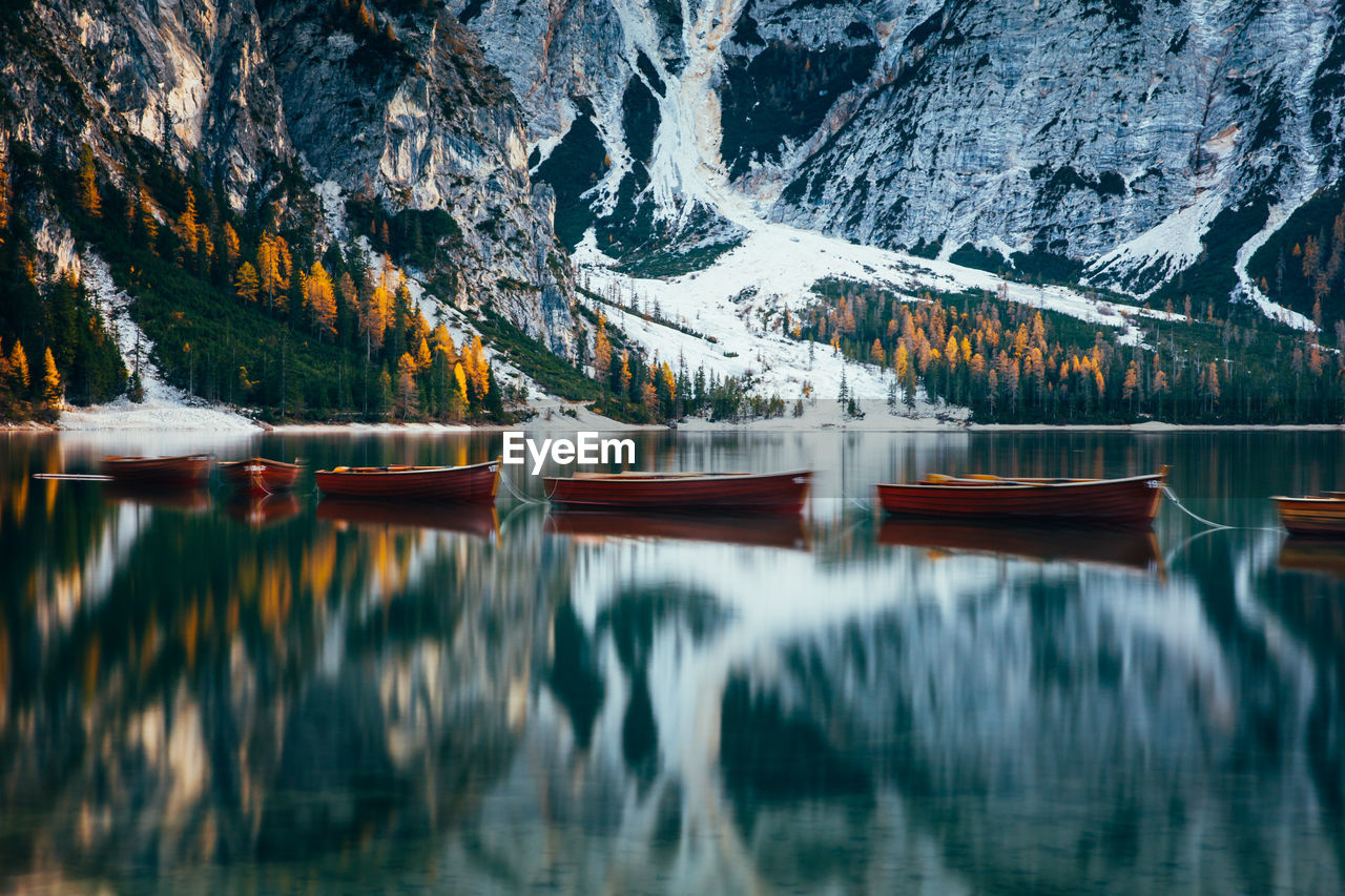 water, mountain, beauty in nature, scenics - nature, reflection, lake, tree, tranquility, tranquil scene, plant, nature, waterfront, winter, day, mountain range, cold temperature, no people, non-urban scene, outdoors, snowcapped mountain