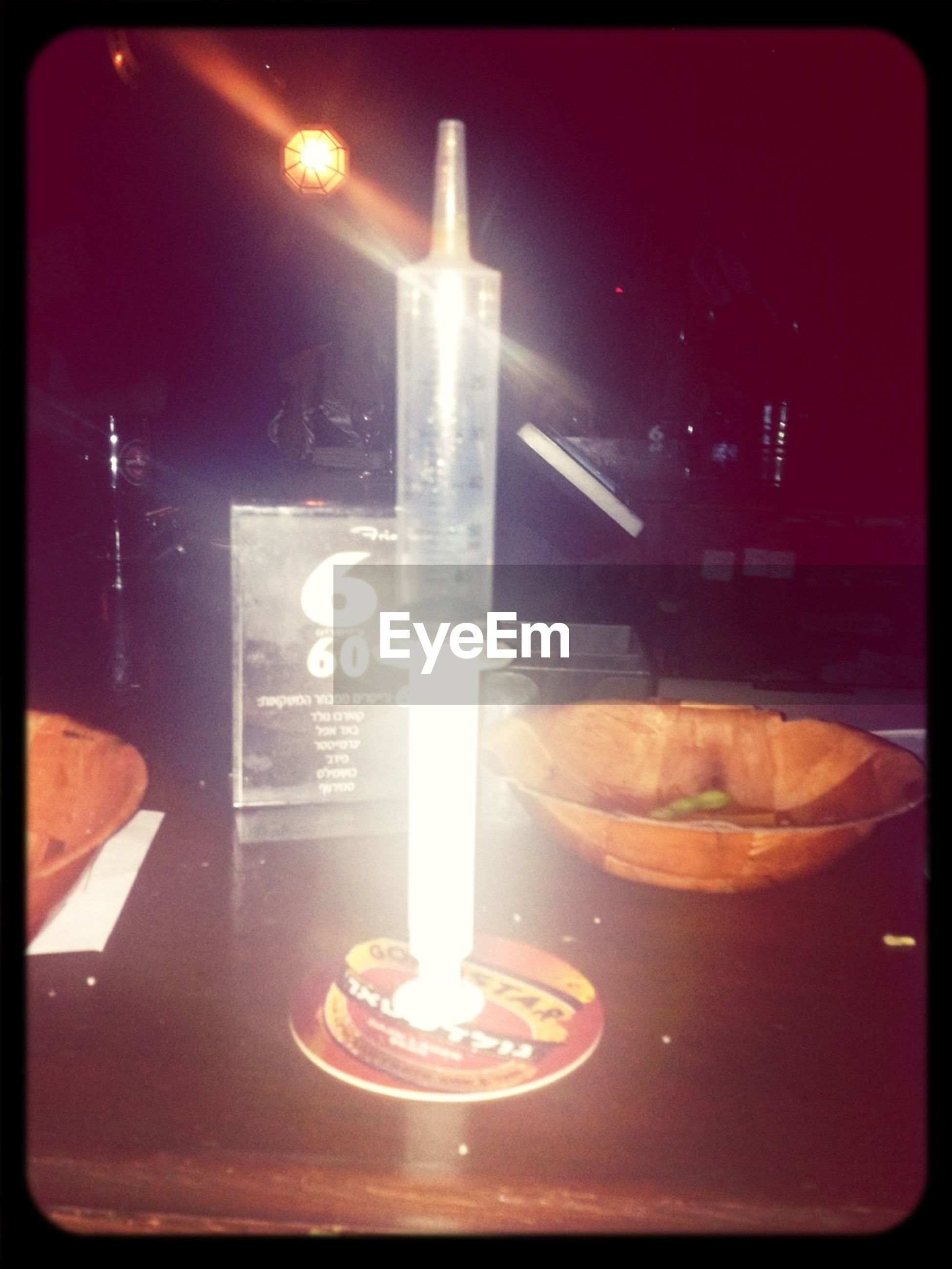 transfer print, auto post production filter, indoors, illuminated, night, glowing, lighting equipment, flame, heat - temperature, table, lit, candle, burning, light - natural phenomenon, fire - natural phenomenon, dark, no people, close-up, food and drink, restaurant