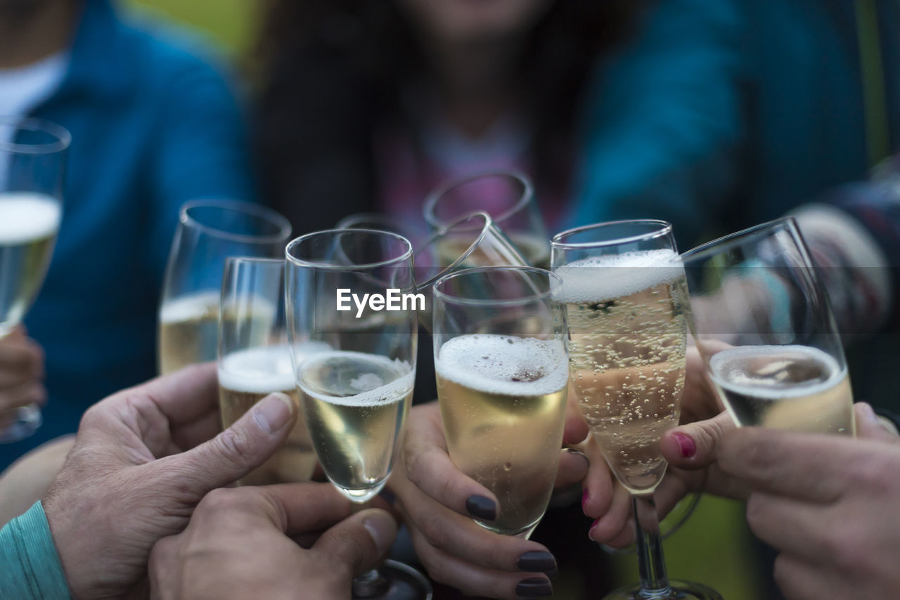 Cropped Image Of People Toasting Drinks