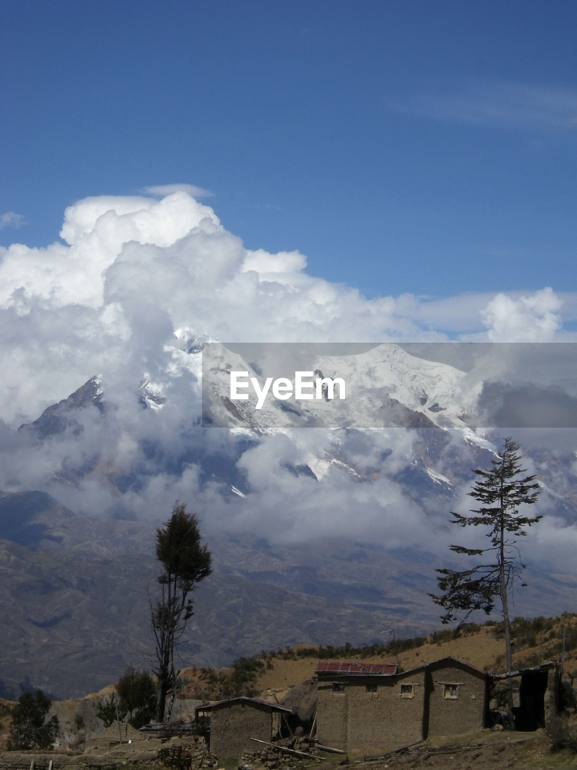 SCENIC VIEW OF SNOWCAPPED MOUNTAINS AND SKY