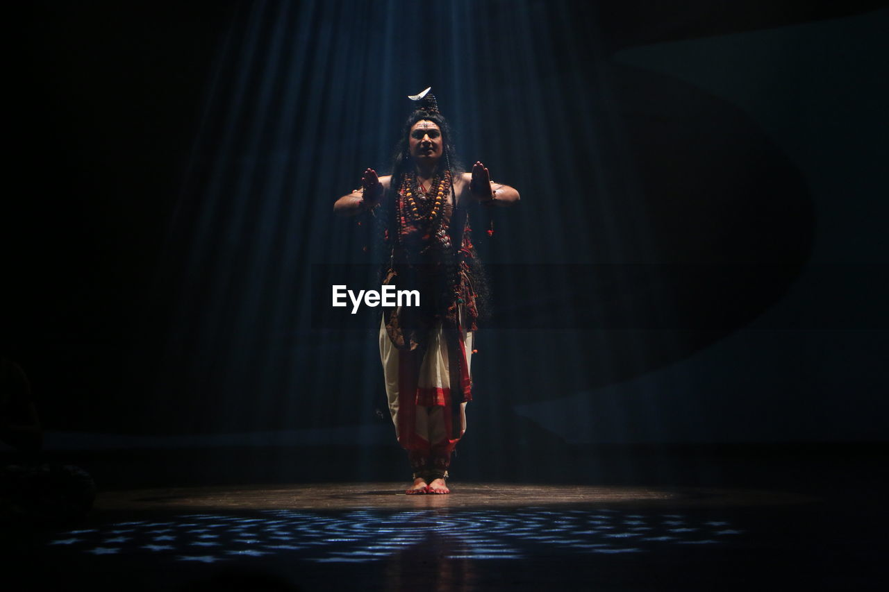Full Length Of Man Wearing Shiva Costume Performing On Stage
