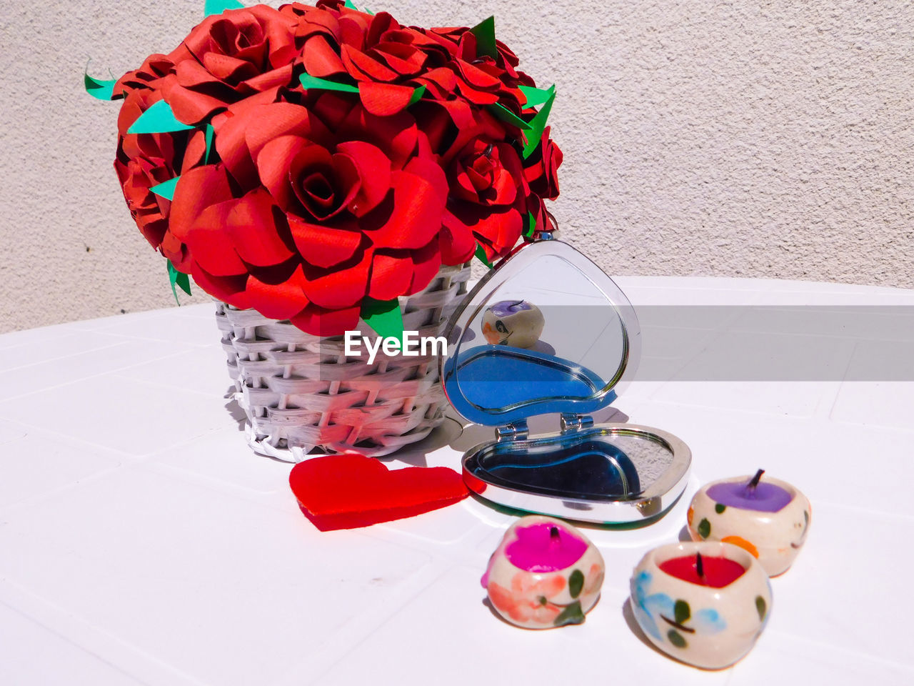 flower, table, no people, indoors, red, high angle view, vase, petal, close-up, fragility, day, freshness, nature, multi colored, flower head