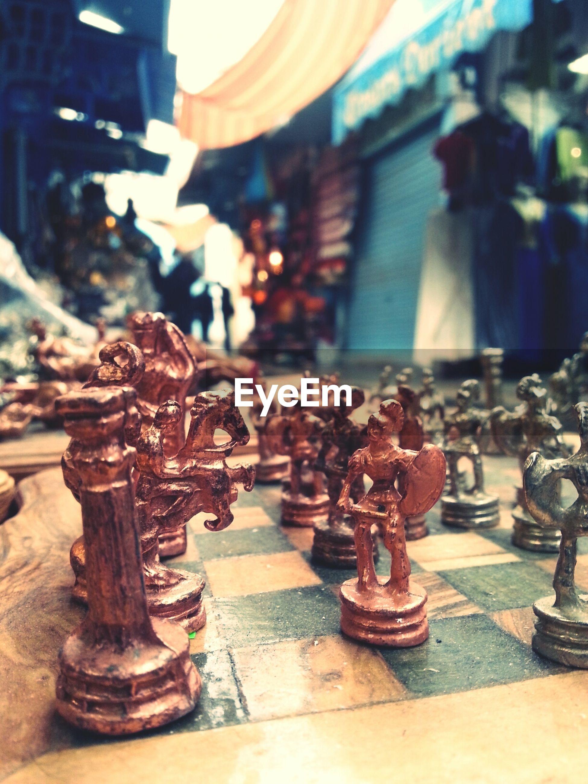 Metallic figurines on chessboard