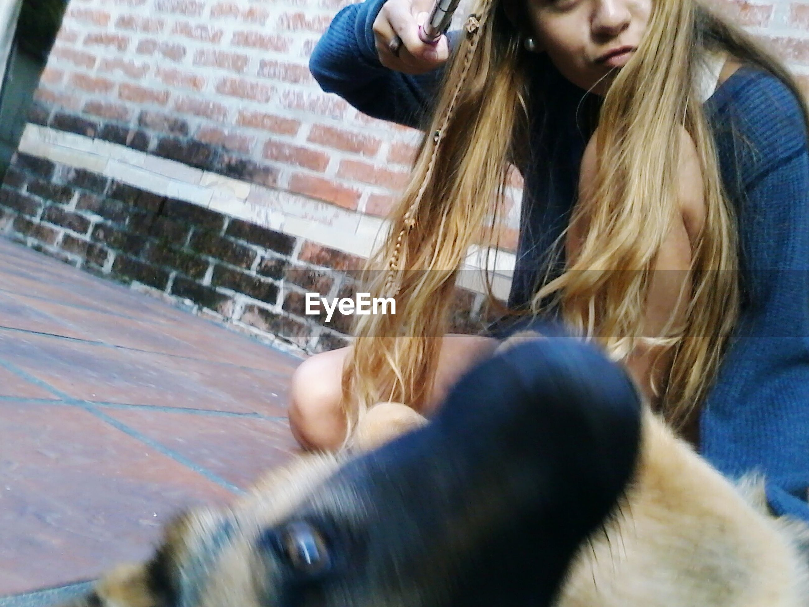 lifestyles, pets, leisure activity, domestic animals, one animal, animal themes, mammal, casual clothing, dog, pet owner, person, long hair, young women, headshot, sitting, togetherness, relaxation