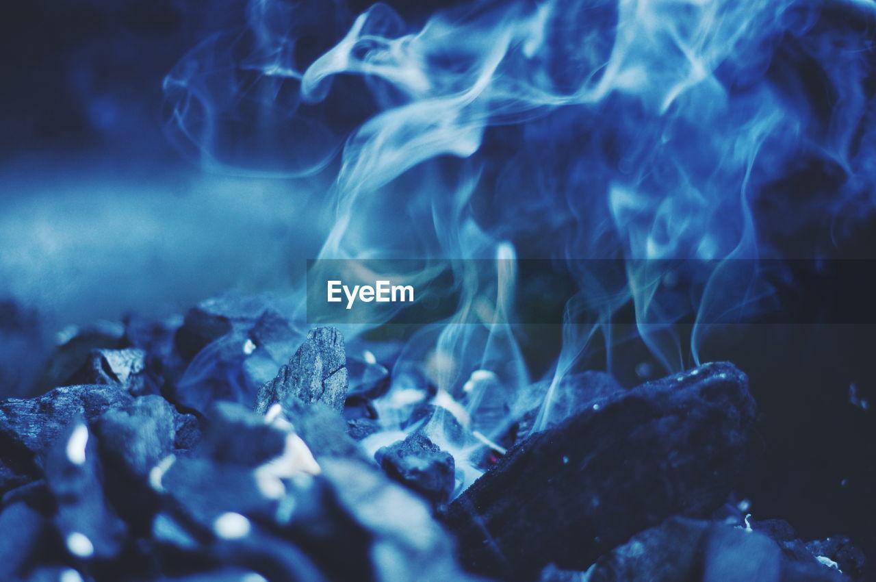 Close-Up Of Smoke And Coal