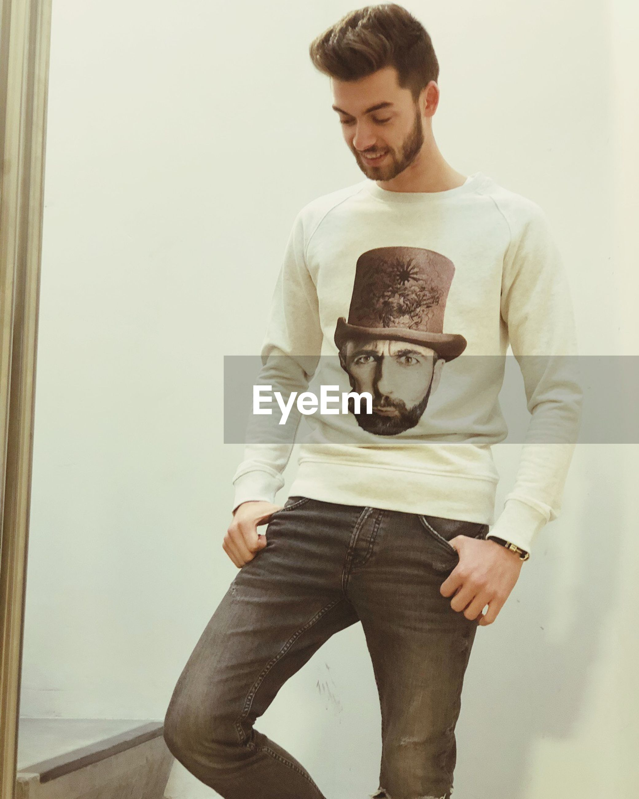 young men, young adult, casual clothing, front view, leisure activity, two people, looking at camera, portrait, holding, real people, standing, indoors, photographing, lifestyles, happiness, studio shot, photography themes, young women, technology, togetherness, smiling, selfie, day