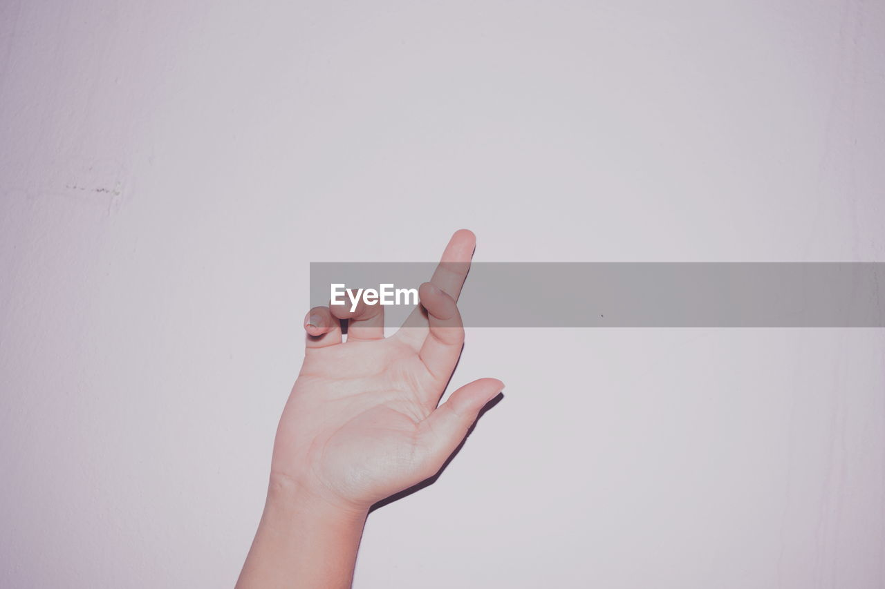 human hand, hand, human body part, studio shot, copy space, one person, finger, human finger, white background, body part, gesturing, indoors, unrecognizable person, showing, hand sign, close-up, personal perspective, pointing, lifestyles