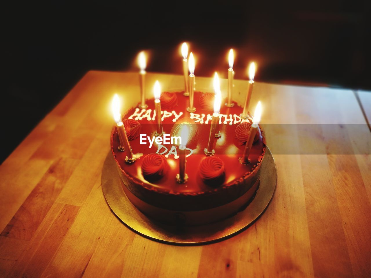 candle, flame, burning, celebration, birthday candles, indoors, text, table, birthday cake, cake, food and drink, heat - temperature, birthday, sweet food, high angle view, illuminated, indulgence, no people, temptation, life events, food, freshness, close-up