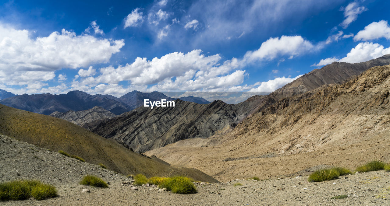 mountain, cloud - sky, sky, scenics - nature, landscape, environment, beauty in nature, tranquil scene, non-urban scene, mountain range, tranquility, nature, day, no people, land, remote, idyllic, physical geography, outdoors, sunlight, arid climate, formation, climate, mountain peak