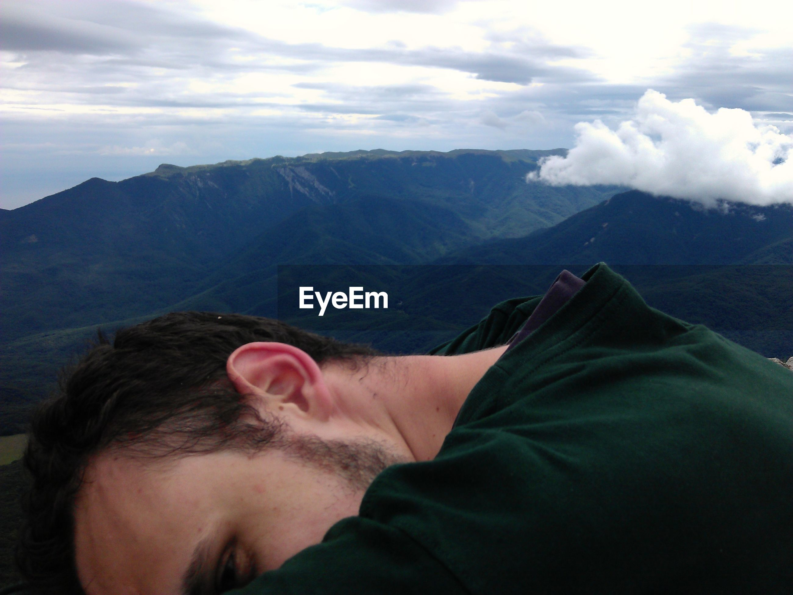 Cropped image of man against mountains