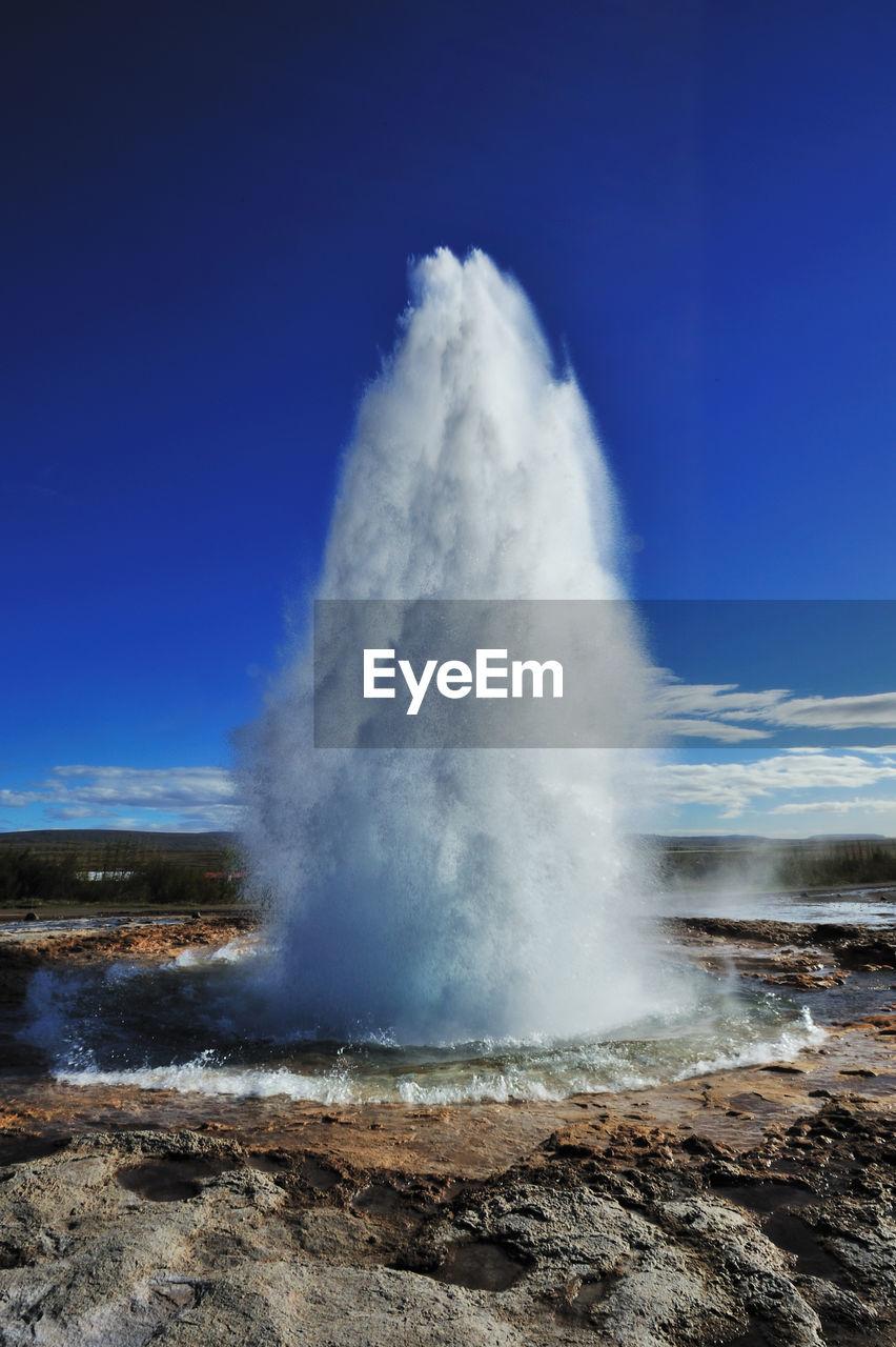 View Of Geyser Against Blue Sky