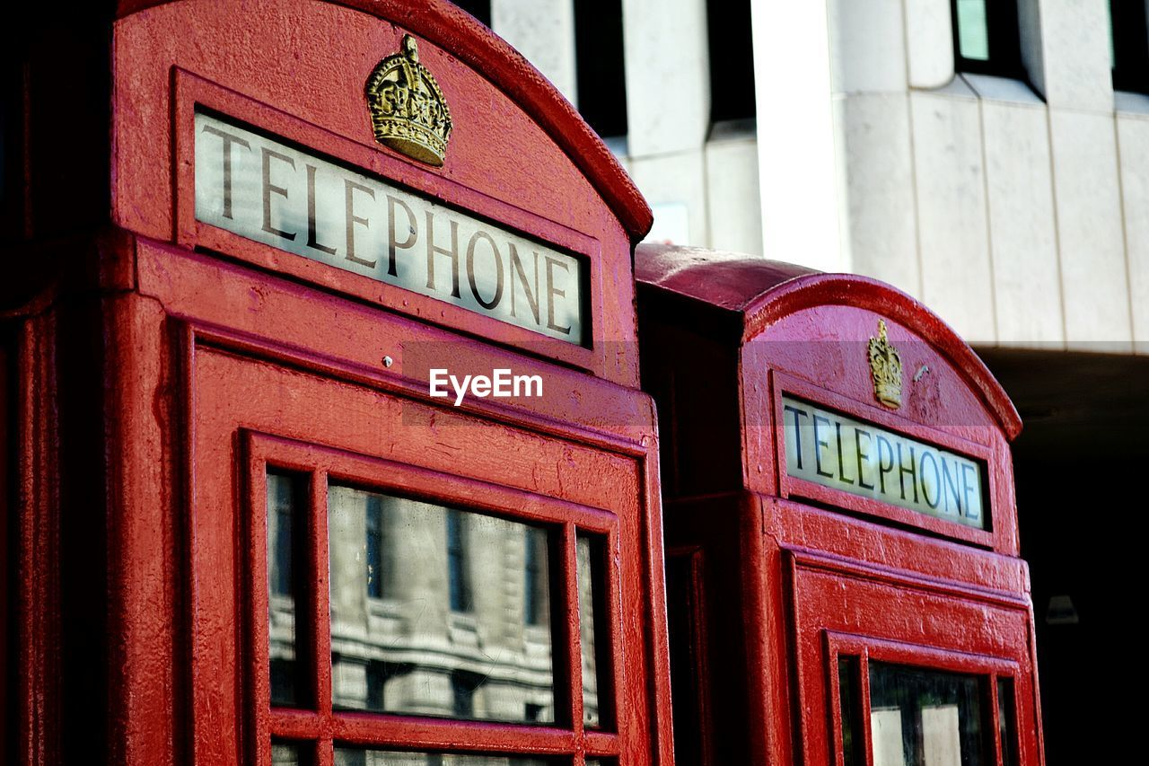 Telephone Booths Against Building