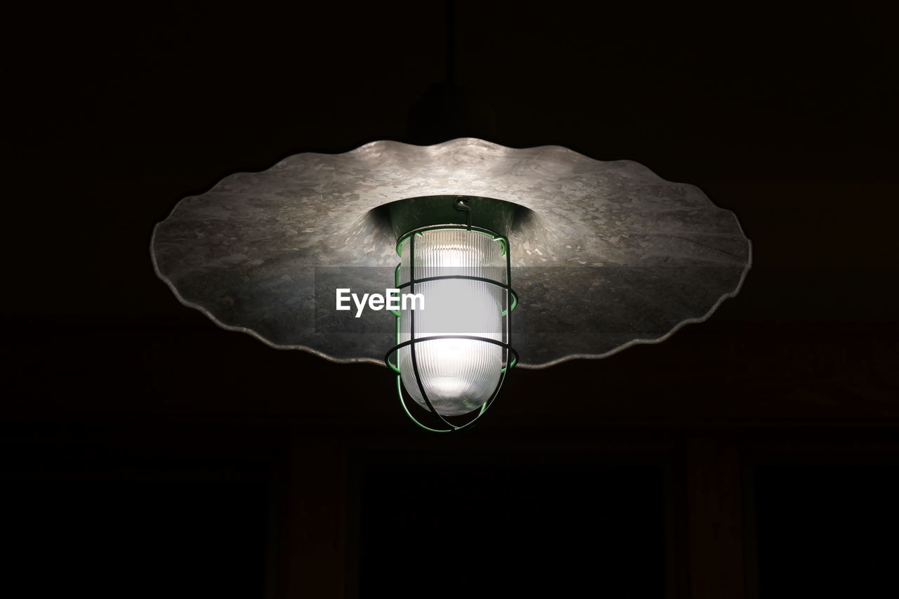 Low Angle View Of Illuminated Electric Bulb