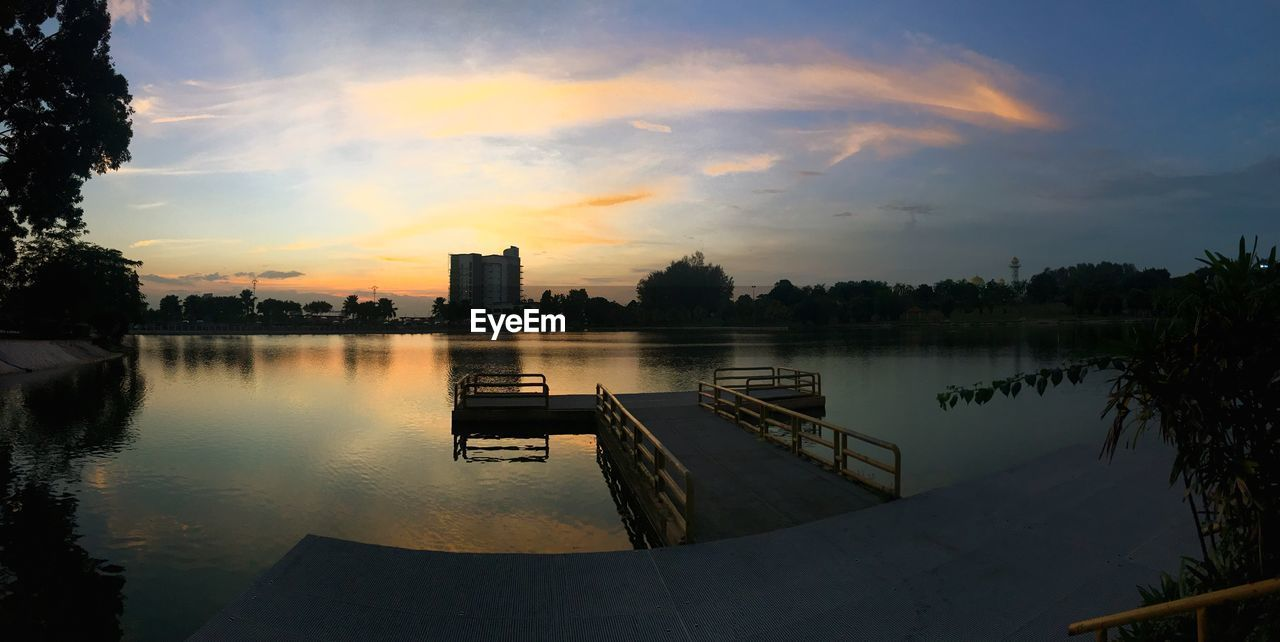 water, reflection, sky, sunset, no people, cloud - sky, outdoors, tranquility, nature, tree, built structure, lake, beauty in nature, scenics, building exterior, architecture, day