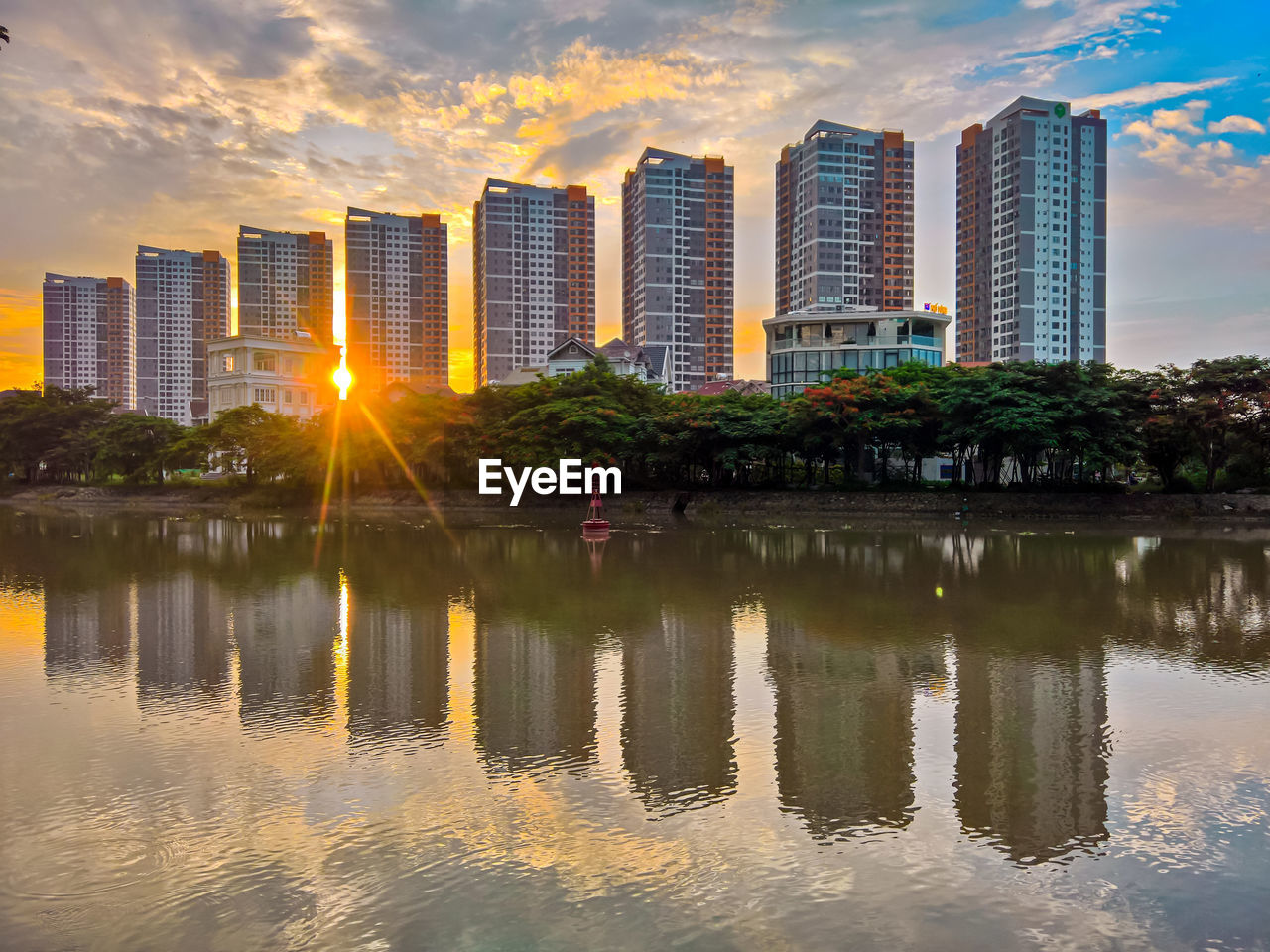 built structure, architecture, reflection, building exterior, water, sky, building, city, office building exterior, sunset, waterfront, cloud - sky, nature, skyscraper, no people, landscape, lake, outdoors, modern, tall - high, cityscape, financial district