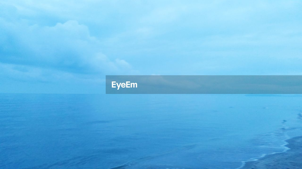 sea, beauty in nature, horizon over water, tranquil scene, scenics, tranquility, nature, water, sky, no people, blue, cloud - sky, idyllic, outdoors, day