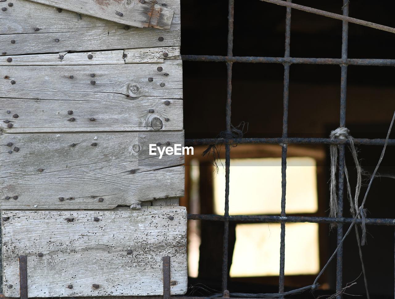 FULL FRAME SHOT OF OLD WINDOW OF BUILDING