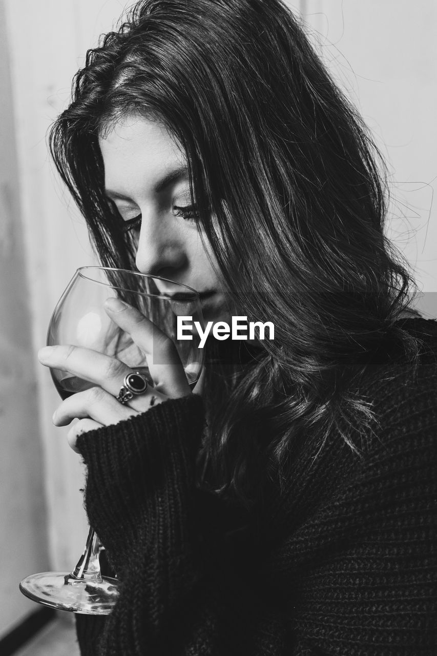 Beautiful Young Woman Drinking Against Sky