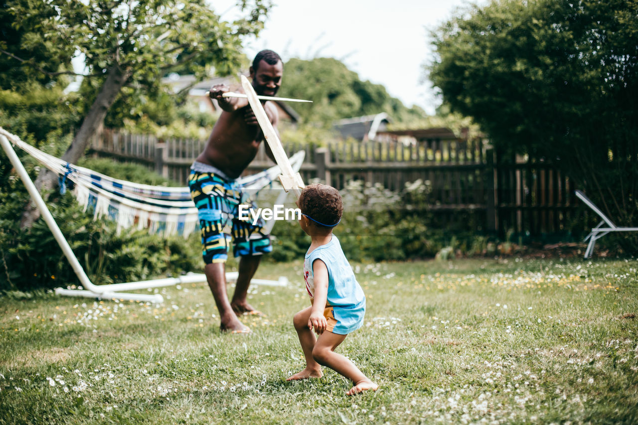 Father and son playing in yard