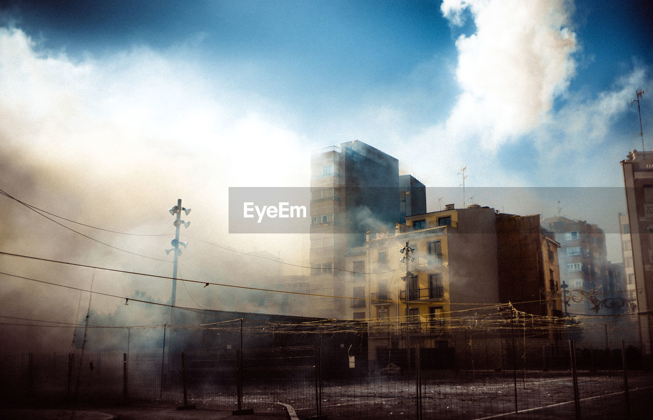 sky, architecture, no people, day, building exterior, cloud - sky, built structure, cable, outdoors, electricity pylon, city, nature