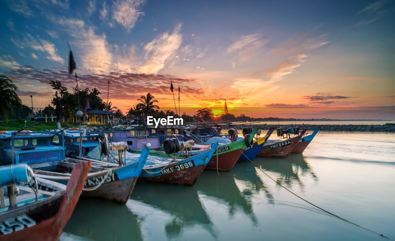 nautical vessel, mode of transportation, transportation, moored, sky, sunset, cloud - sky, water, nature, scenics - nature, beauty in nature, sea, orange color, no people, tranquility, reflection, tranquil scene, beach, outdoors, fishing industry, fishing boat, port, marina