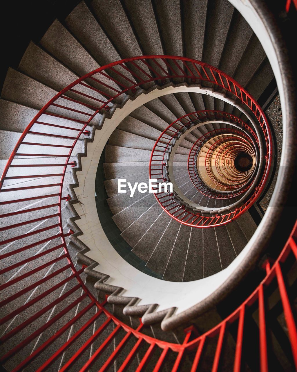 spiral, staircase, steps and staircases, architecture, spiral staircase, railing, indoors, pattern, design, built structure, diminishing perspective, shape, no people, high angle view, red, swirl, directly above, geometric shape, circle, metal