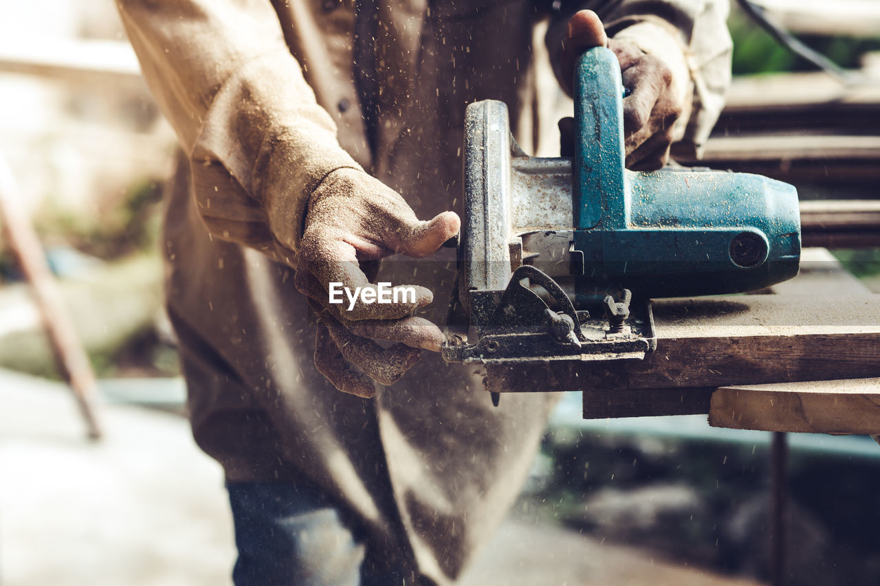 Close-up of man working with machine