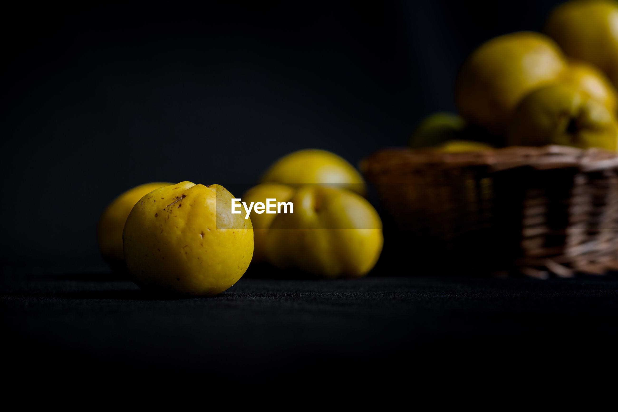Close-up of fruits in darkroom