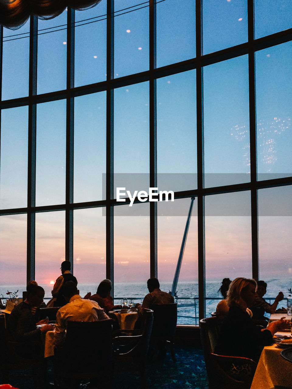People In Restaurant Cruise Ship During Sunset