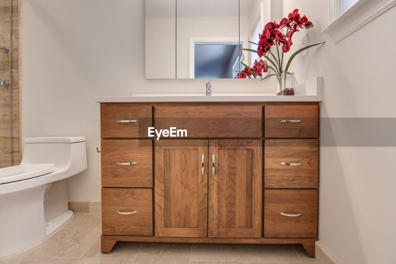 Wooden closed cabinet in bathroom