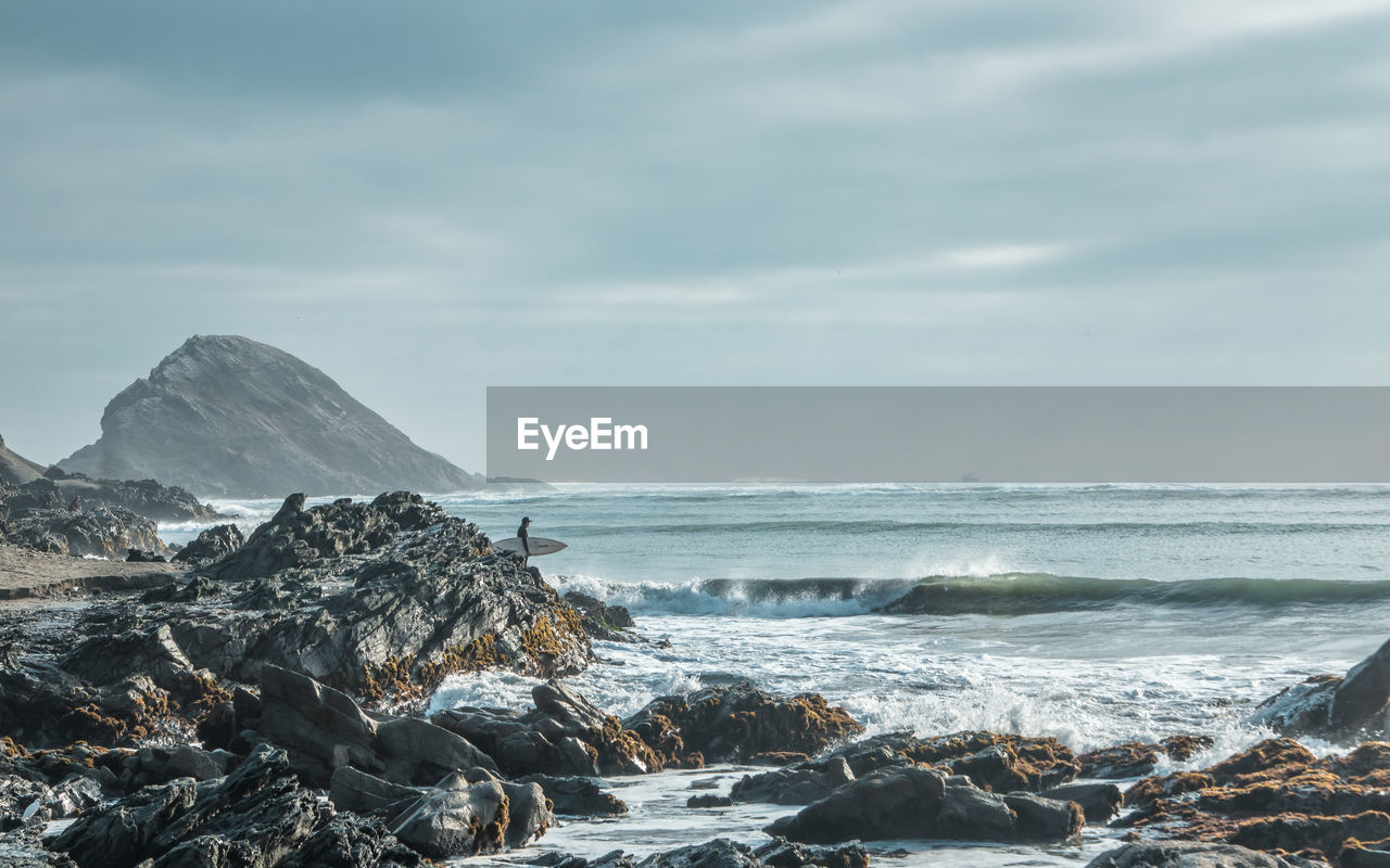 sea, water, sky, beauty in nature, scenics - nature, rock, cloud - sky, land, motion, nature, rock - object, solid, beach, day, no people, wave, horizon, horizon over water, outdoors, power in nature