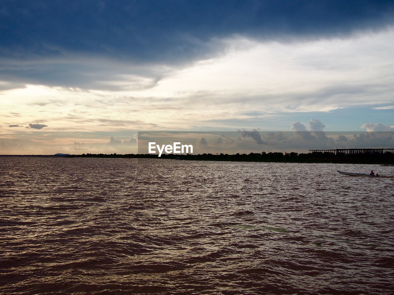 water, sky, cloud - sky, waterfront, scenics - nature, tranquil scene, tranquility, beauty in nature, sea, no people, nature, rippled, sunset, idyllic, non-urban scene, outdoors, environment, land, dusk, view into land