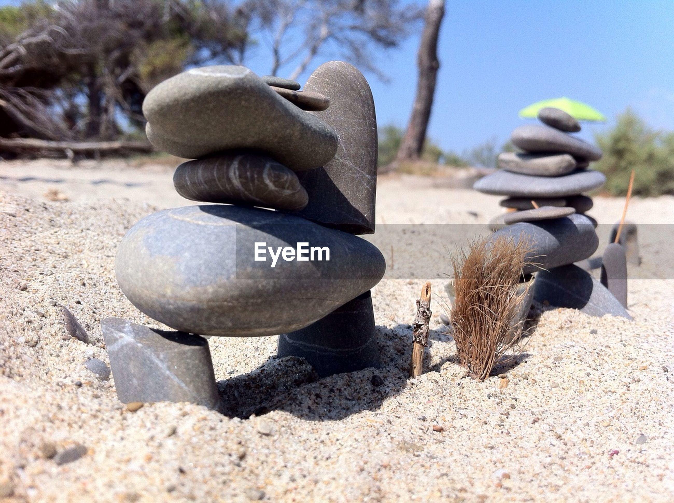 Stacks of pebbles at sandy beach