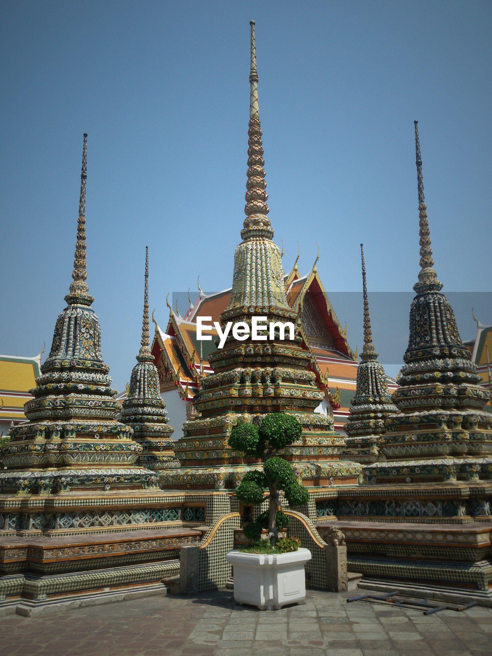 Wat pho temple against clear sky