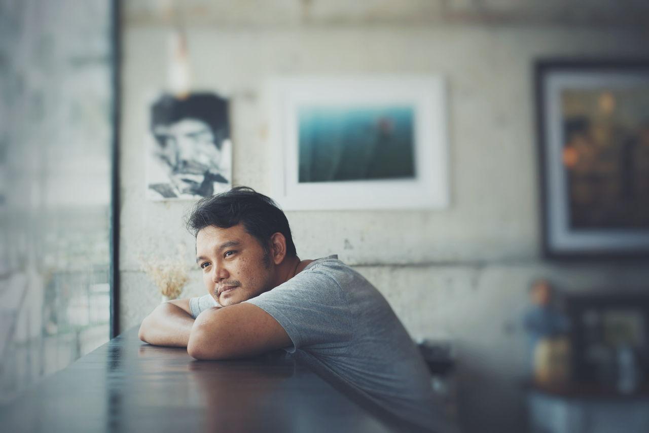 Close-Up Of Man Sitting At Table