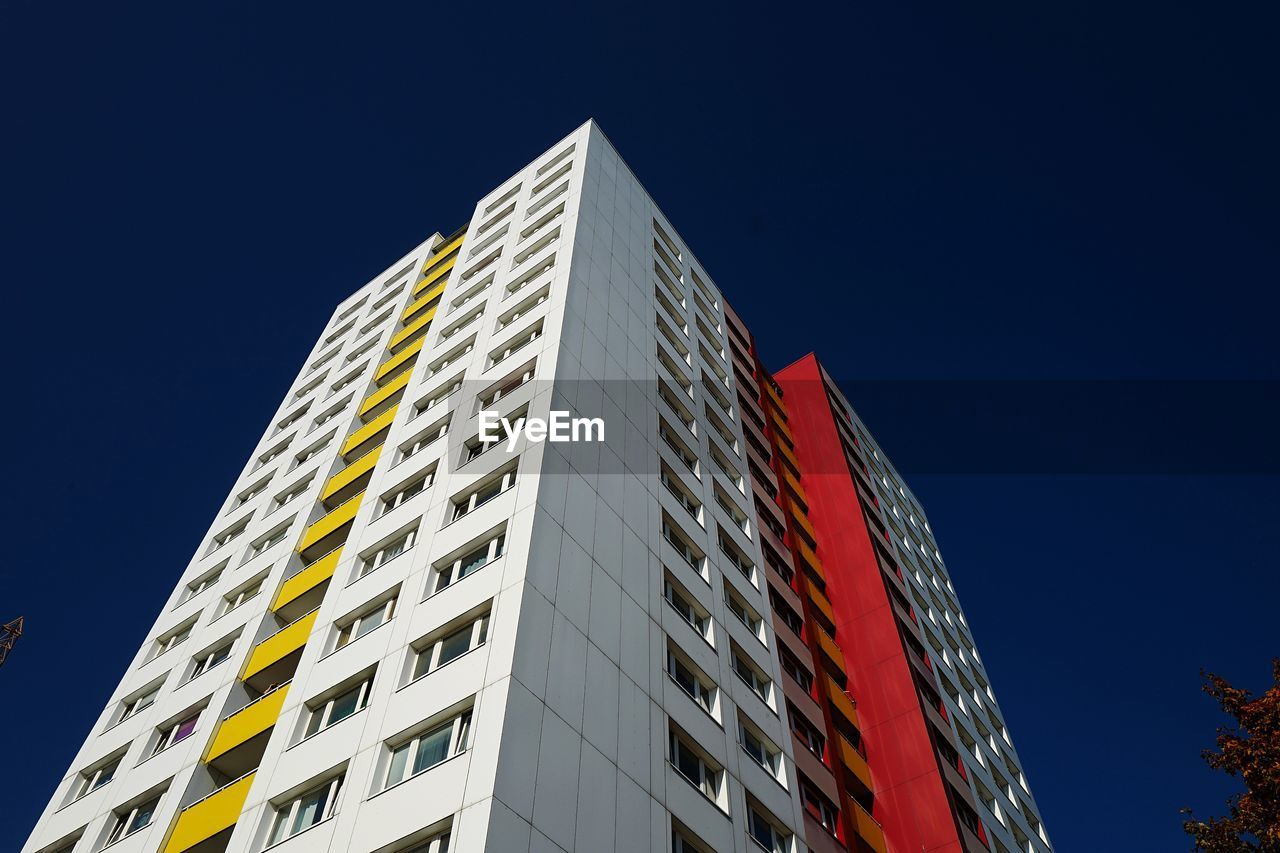 built structure, architecture, low angle view, sky, building exterior, building, clear sky, no people, nature, blue, window, city, modern, outdoors, copy space, sunlight, office building exterior, office, tall - high, day, skyscraper, apartment