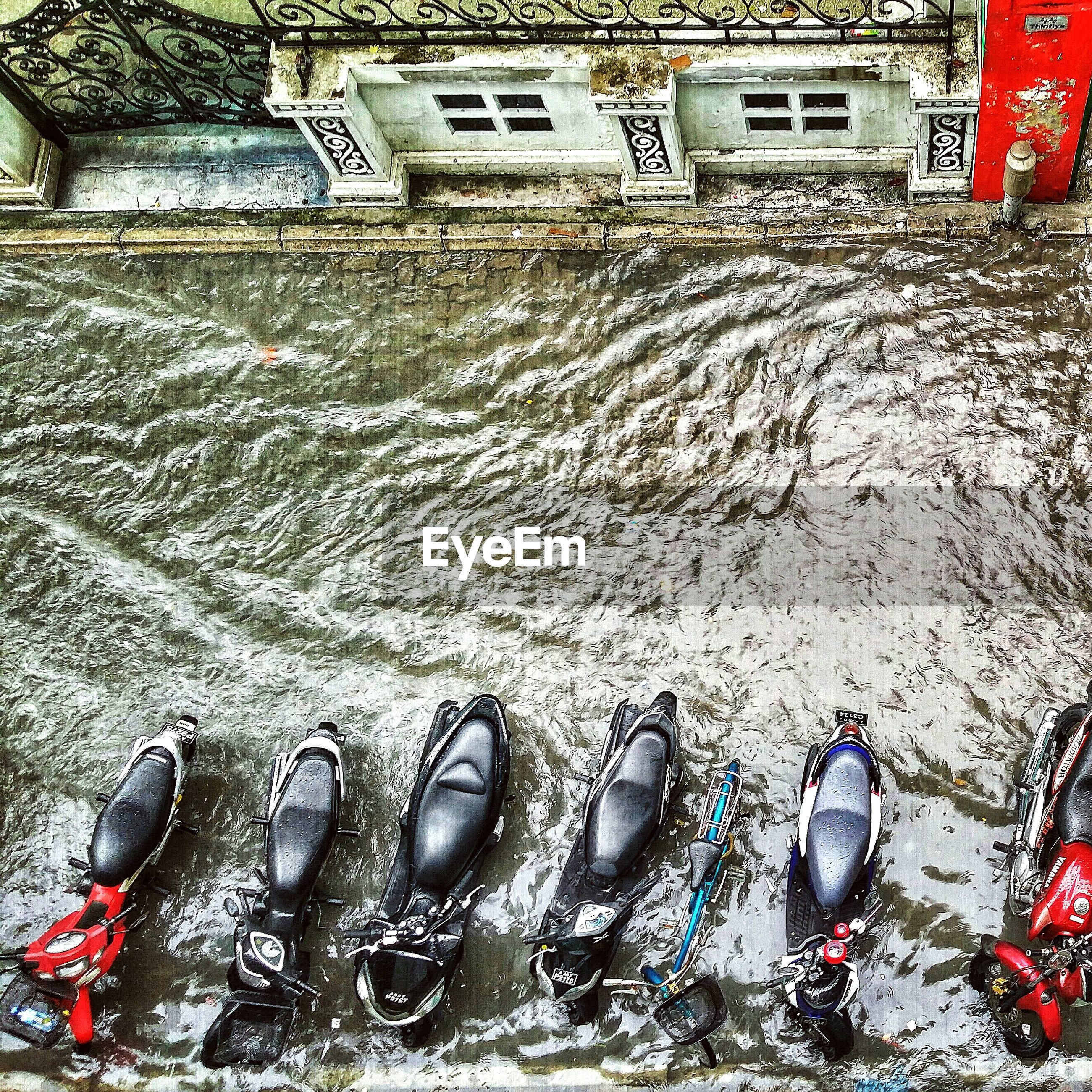 Motorcycles parked on flooded road