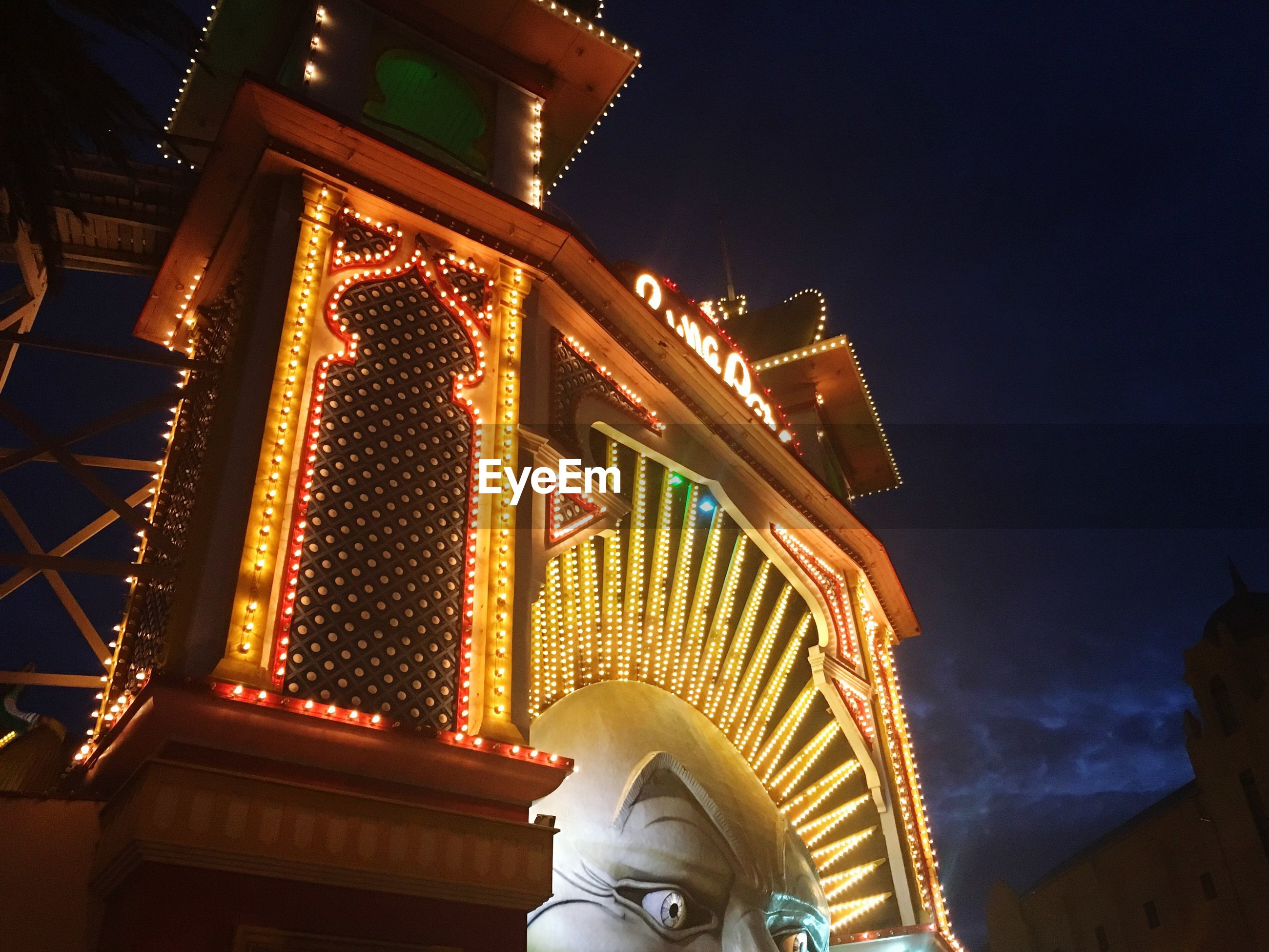 architecture, low angle view, illuminated, built structure, building exterior, night, sky, outdoors, travel destinations, real people, one person, people