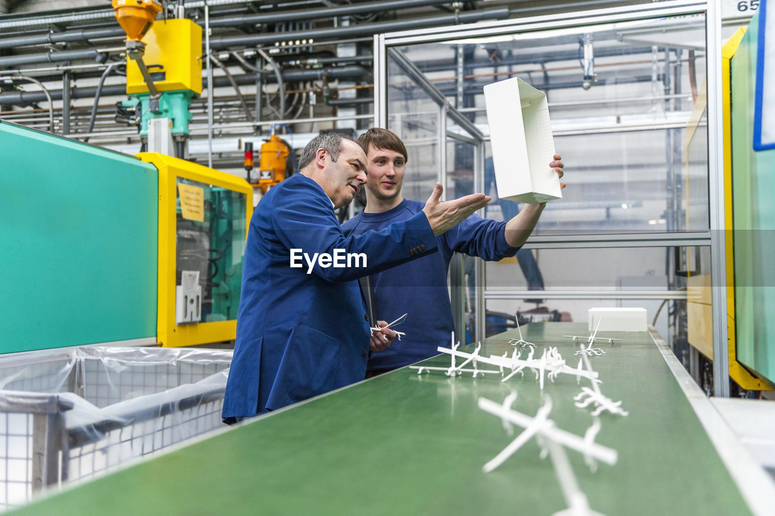 MEN WORKING IN INDUSTRY