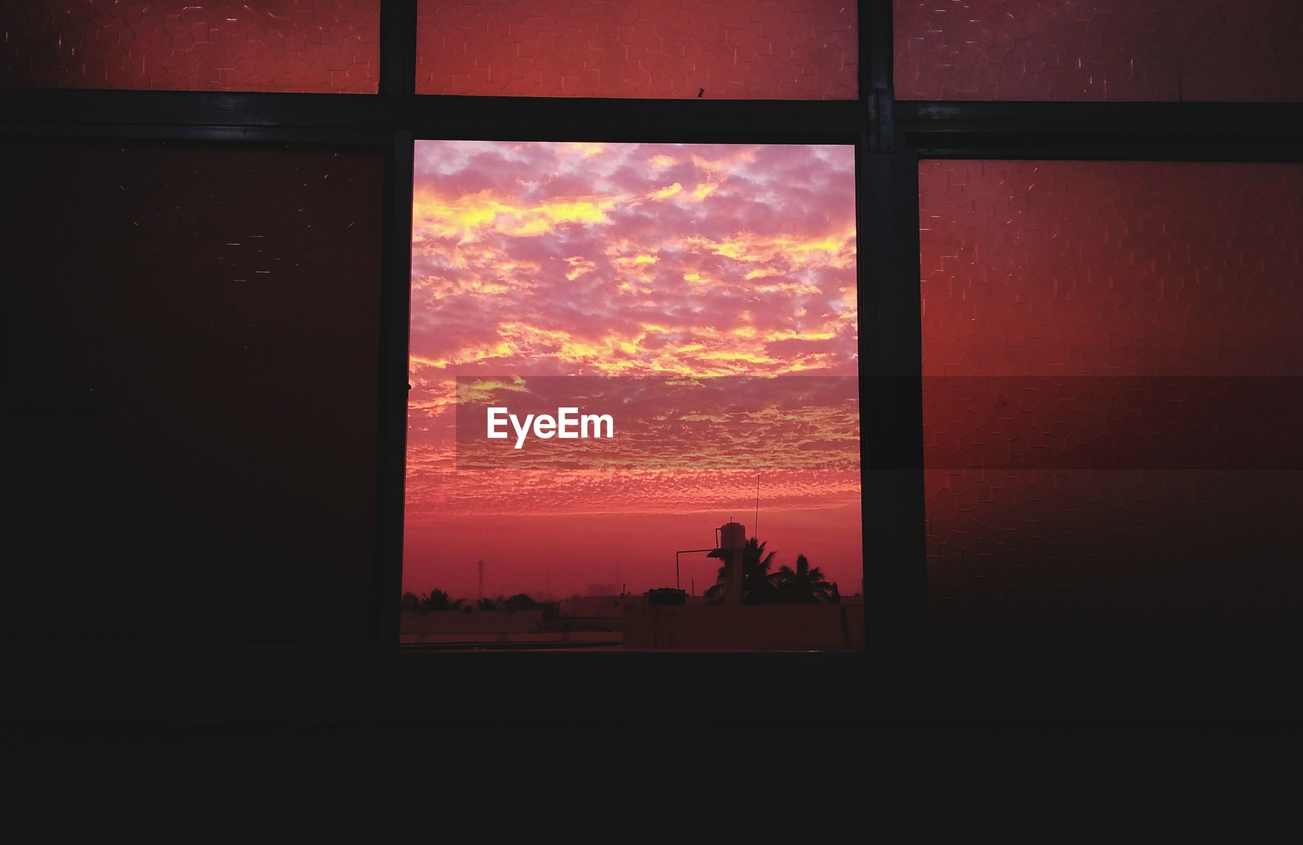 Dramatic sky seen through window