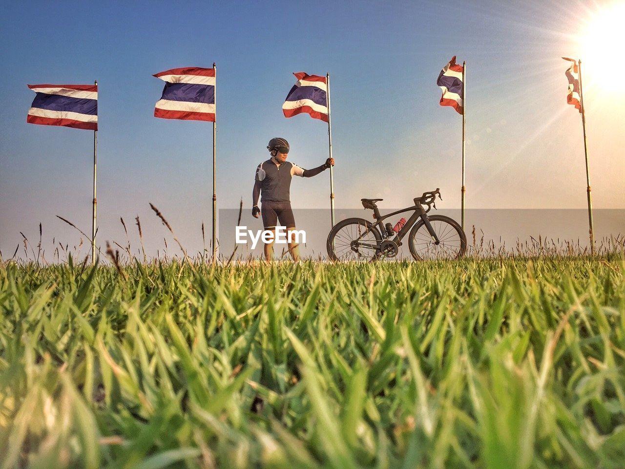 Man Holding Thailand Flag