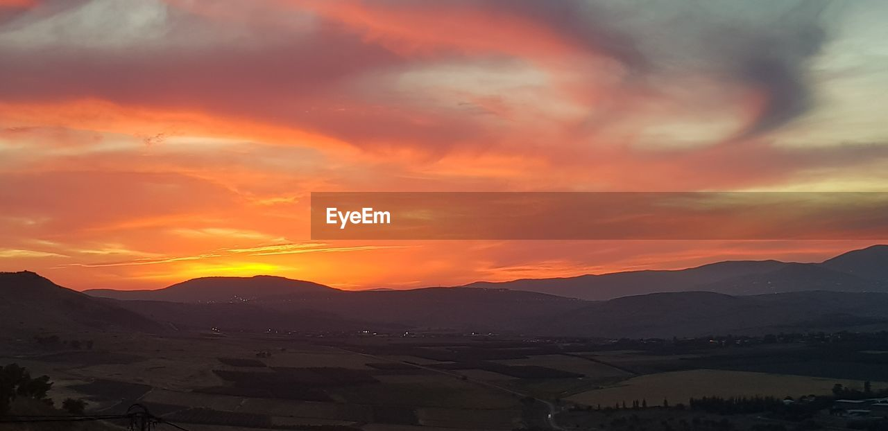 sky, sunset, scenics - nature, beauty in nature, mountain, cloud - sky, orange color, environment, tranquil scene, tranquility, landscape, mountain range, non-urban scene, nature, no people, idyllic, silhouette, outdoors, dramatic sky, remote