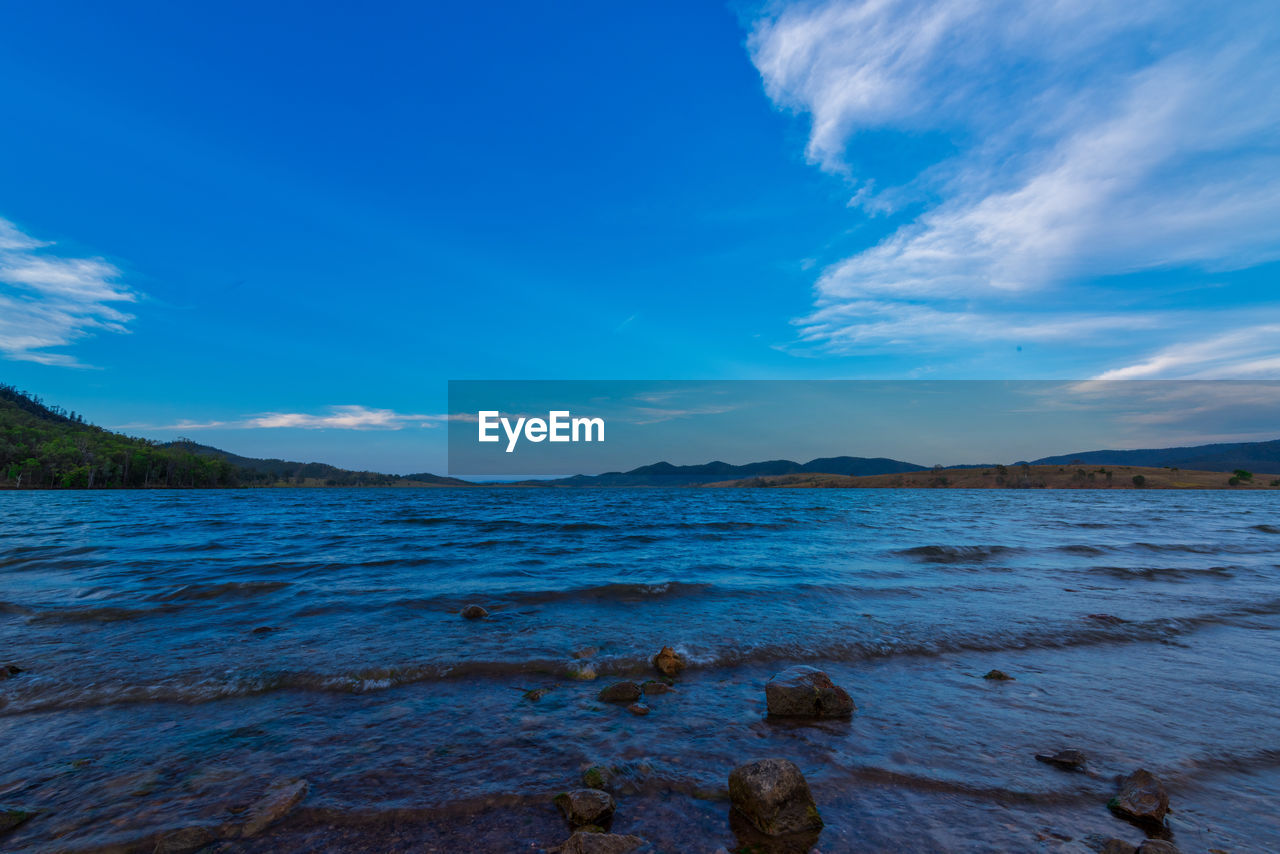 sky, water, cloud - sky, scenics - nature, beauty in nature, tranquil scene, tranquility, blue, sea, nature, land, rock, no people, day, non-urban scene, idyllic, beach, solid, rock - object, outdoors
