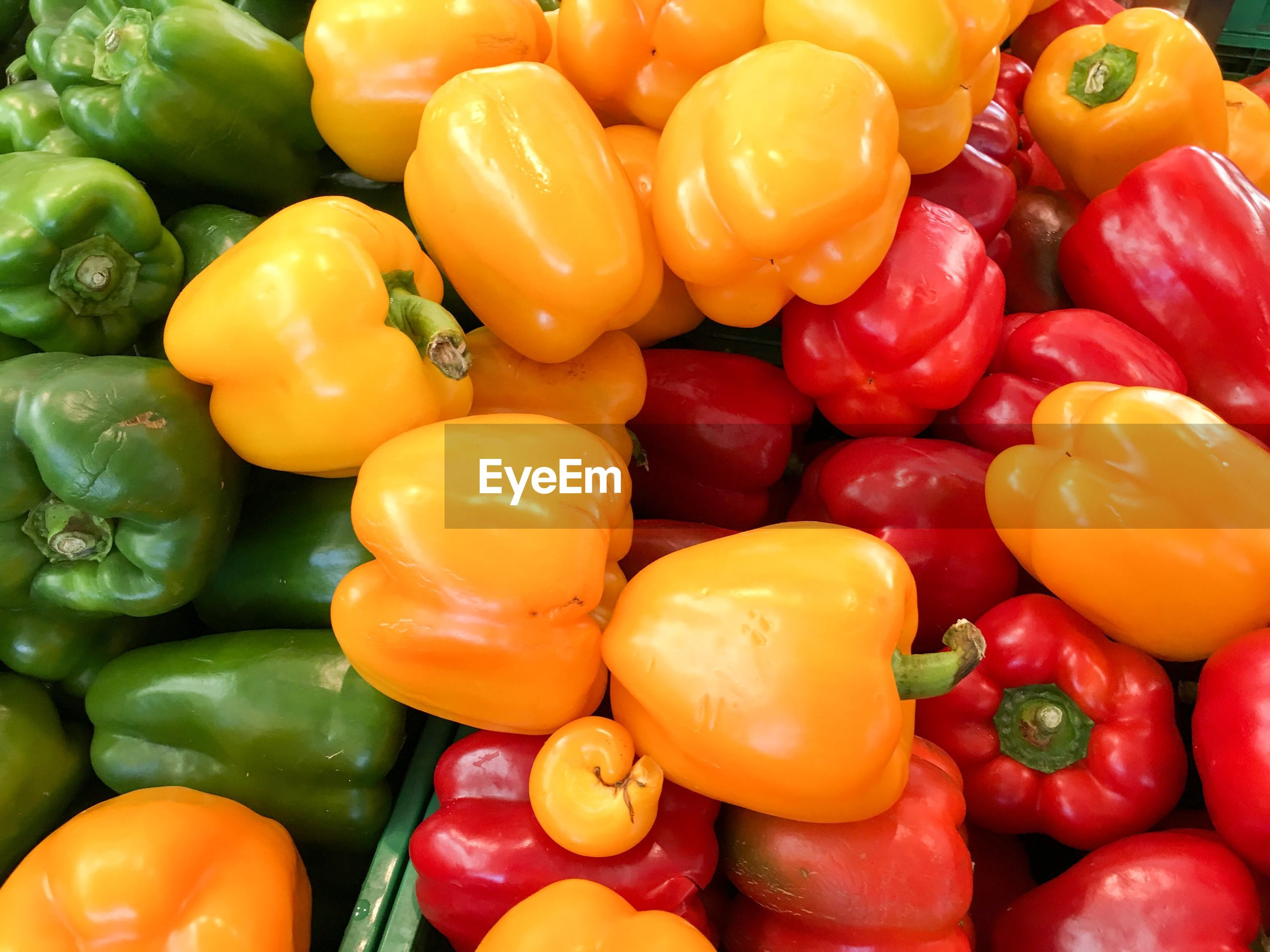 Full frame shot of colorful bell peppers for sale at market stall